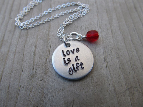 "Love Is A Gift Inspiration Necklace- ""love is a gift""- Hand-Stamped Necklace with an accent bead in your choice of colors"