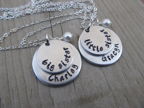 "Personalized set of 2 Sisters Necklaces- 2 Necklace Set- ""big sister"", ""little sister"" each with a name disc and an accent bead of your choice- 2 necklace set"