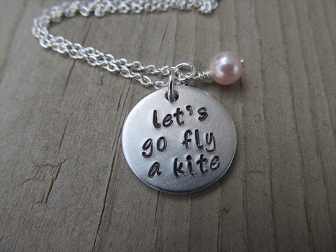 "Let's Go Fly a Kite Inspiration Necklace ""let's go fly a kite"" - Hand-Stamped Necklace with an accent bead in your choice of colors"