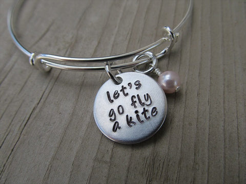 "Let's Go Fly a Kite Inspiration Bracelet- ""let's go fly a kite""  - Hand-Stamped Bracelet-Adjustable Bracelet with an accent bead of your choice"