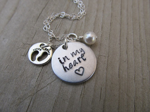 "Baby Loss/Miscarriage Necklace- Hand-stamped necklace, ""in my heart"" with stamped heart and baby footprints charm - Hand-Stamped Necklace  -with an accent bead of your choice"