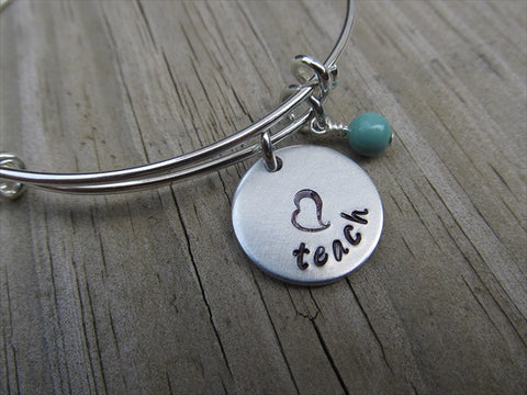 "Teacher's Inspiration Bracelet- ""teach"" with a stamped heart  - Hand-Stamped Bracelet  -Adjustable Bangle Bracelet with an accent bead of your choice"