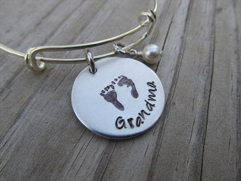 "Grandma Bracelet- ""Grandma"" with stamped baby feet-  Hand-Stamped Bracelet- Adjustable Bangle Bracelet with an accent bead of your choice"