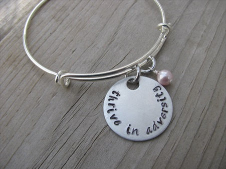 "Thrive in Adversity Bracelet- ""thrive in adversity"" - Hand-Stamped Bracelet- Adjustable Bangle Bracelet with an accent bead of your choice"