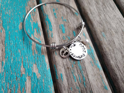 "Expectant Mother Bracelet Gift- ""...coming (year of your choice)""- with baby feet charm - Hand-Stamped Bracelet with an accent bead in your choice of colors"