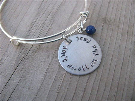 "Don't Dwell On The Past Inspiration Bracelet- ""don't dwell on the past"" - Hand-Stamped Bracelet- Adjustable Bangle Bracelet with an accent bead of your choice"