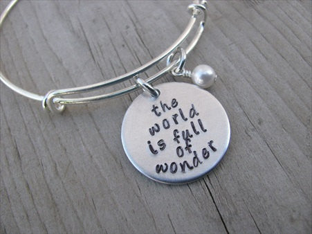 "The World is Full of Wonder Bracelet- ""the world is full of wonder"" - Hand-Stamped Bracelet- Adjustable Bangle Bracelet with an accent bead of your choice"
