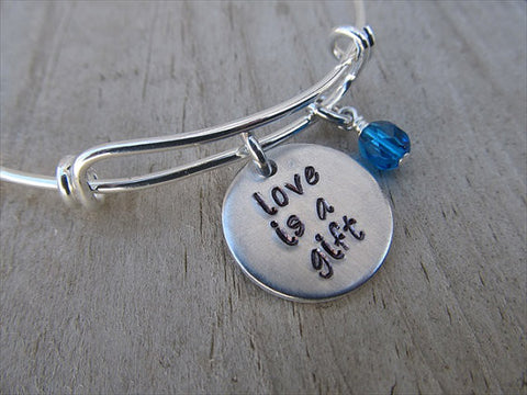 "Love is a Gift Bracelet- ""love is a gift""  - Hand-Stamped Bracelet- Adjustable Bangle Bracelet with an accent bead in your choice of colors"