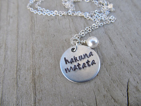 "Hakuna Matata Inspiration Necklace- ""hakuna matata"" - Hand-Stamped Necklace with an accent bead in your choice of colors"