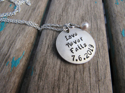 "Love Never Fails Necklace - ""Love Never Fails"" with a date and accent bead of your choice"