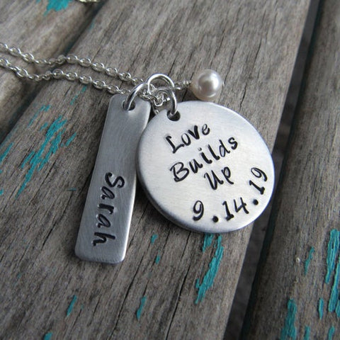 "Love Builds Up Necklace- ""Love Builds Up"" with a date, name charm, and accent bead of your choice - Hand-Stamped Necklace"
