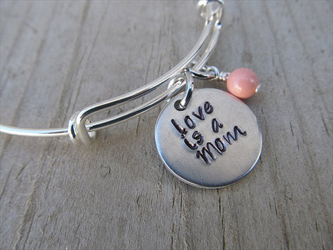 "Love is a Mom Bracelet- ""love is a Mom""  - Hand-Stamped Bracelet- Adjustable Bangle Bracelet with an accent bead in your choice of colors"