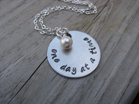 "One Day At A Time Inspiration Necklace- ""one day at a time"" - Hand-Stamped Necklace with an accent bead in your choice of colors"