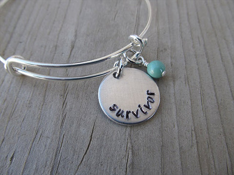 "Survivor Bracelet- ""survivor""  - Hand-Stamped Bracelet- Adjustable Bangle Bracelet with an accent bead of your choice"