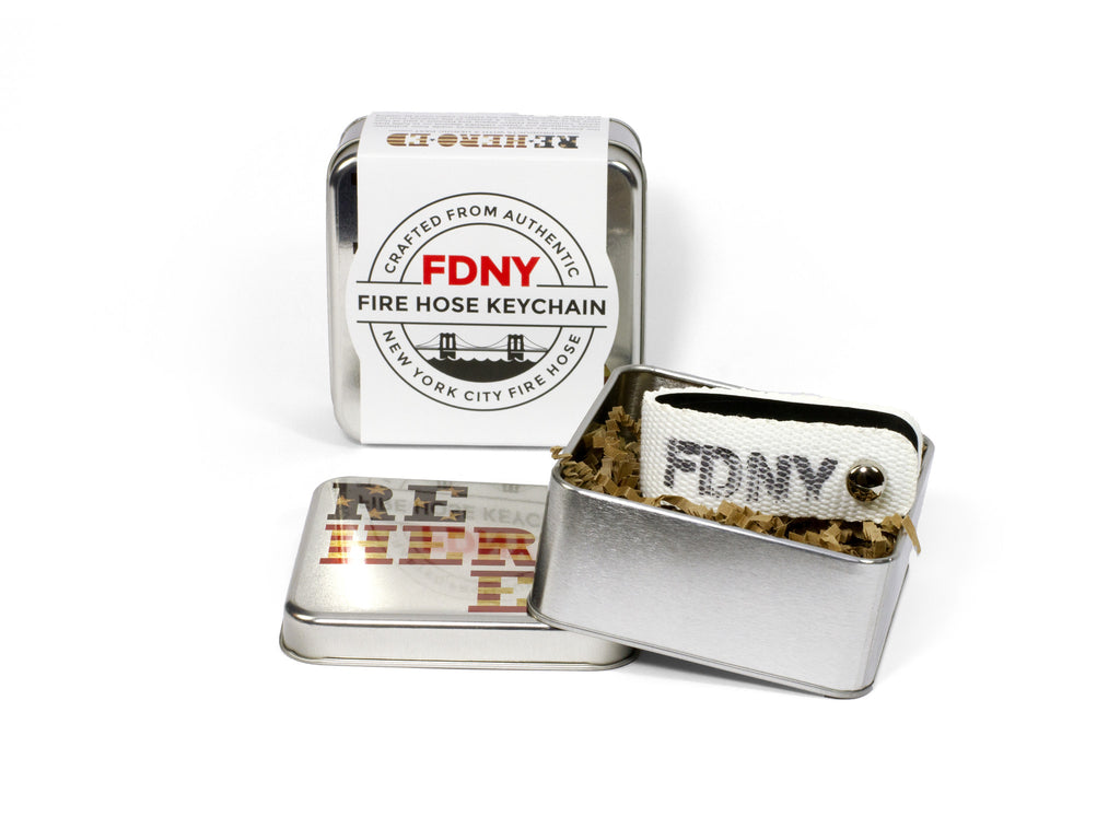 FDNY fire hose keychain ships in decorative gift tin with Reheroed logo on lid.