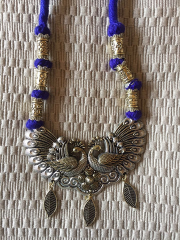 Dancing Peacocks Two toned ethnic thread jewelery