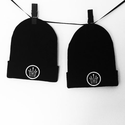 Black beanie with embroidered crown badge