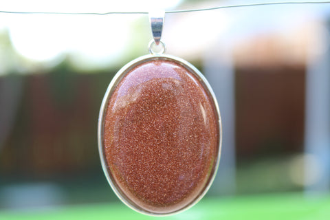 Large Oval Goldstone Pendant - Amazon Imports, Inc. - Fine Quality Gemstones and Jewelry Since 1978