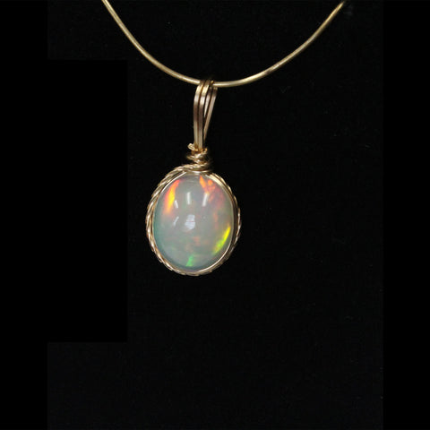 Ethiopian Opal Gemstone Pendant wrapped in 14kt. Gold Filled Wire - Amazon Imports, Inc. - Fine Quality Gemstones and Jewelry Since 1978