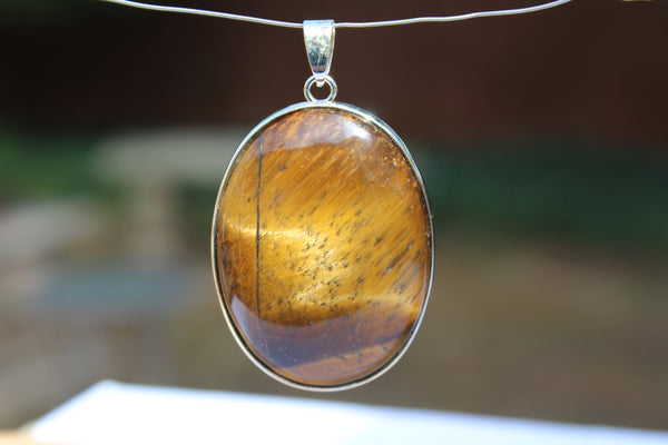 Large Oval Tiger's Eye Pendant - Amazon Imports, Inc. - Fine Quality Gemstones and Jewelry Since 1978