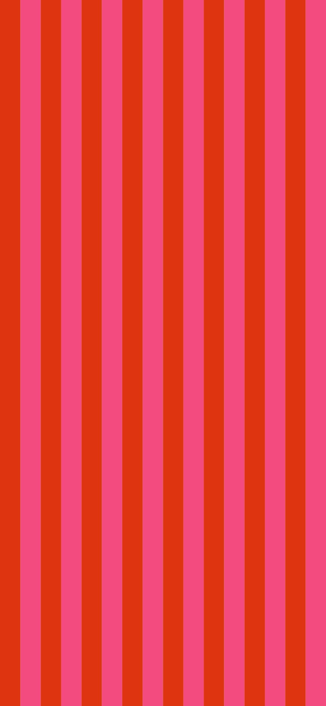 vertical red and pink stripe wallpaper