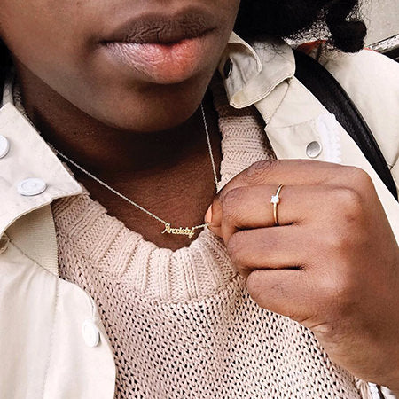 photo of girl wearing the Anxiety necklace