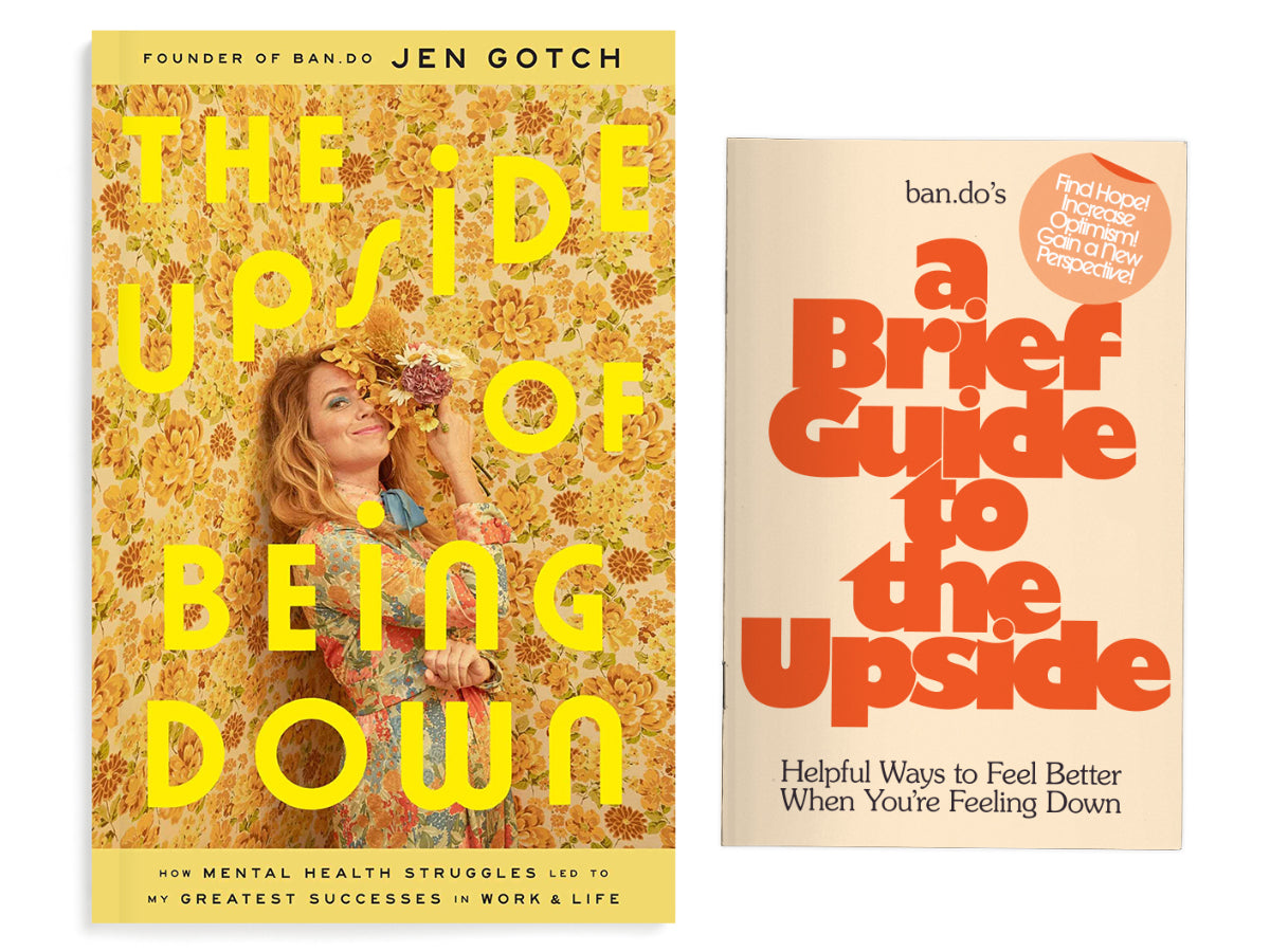 book covers of The Upside of Being Down and the free Zine
