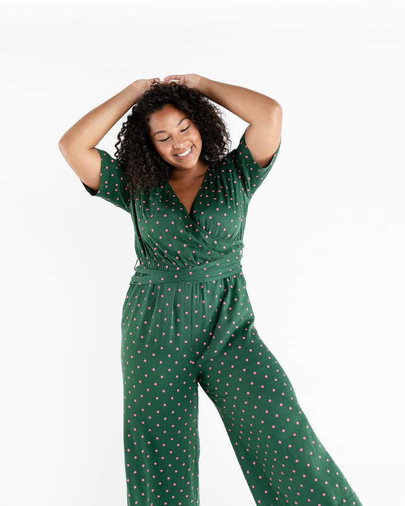 Size adjustable green polka dot jumpsuit.