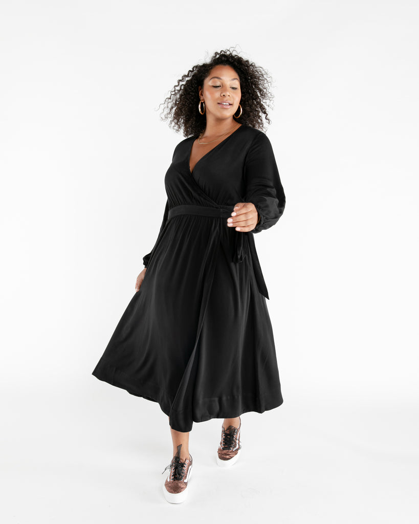 Size adjustable black wrap dress with a long tie.