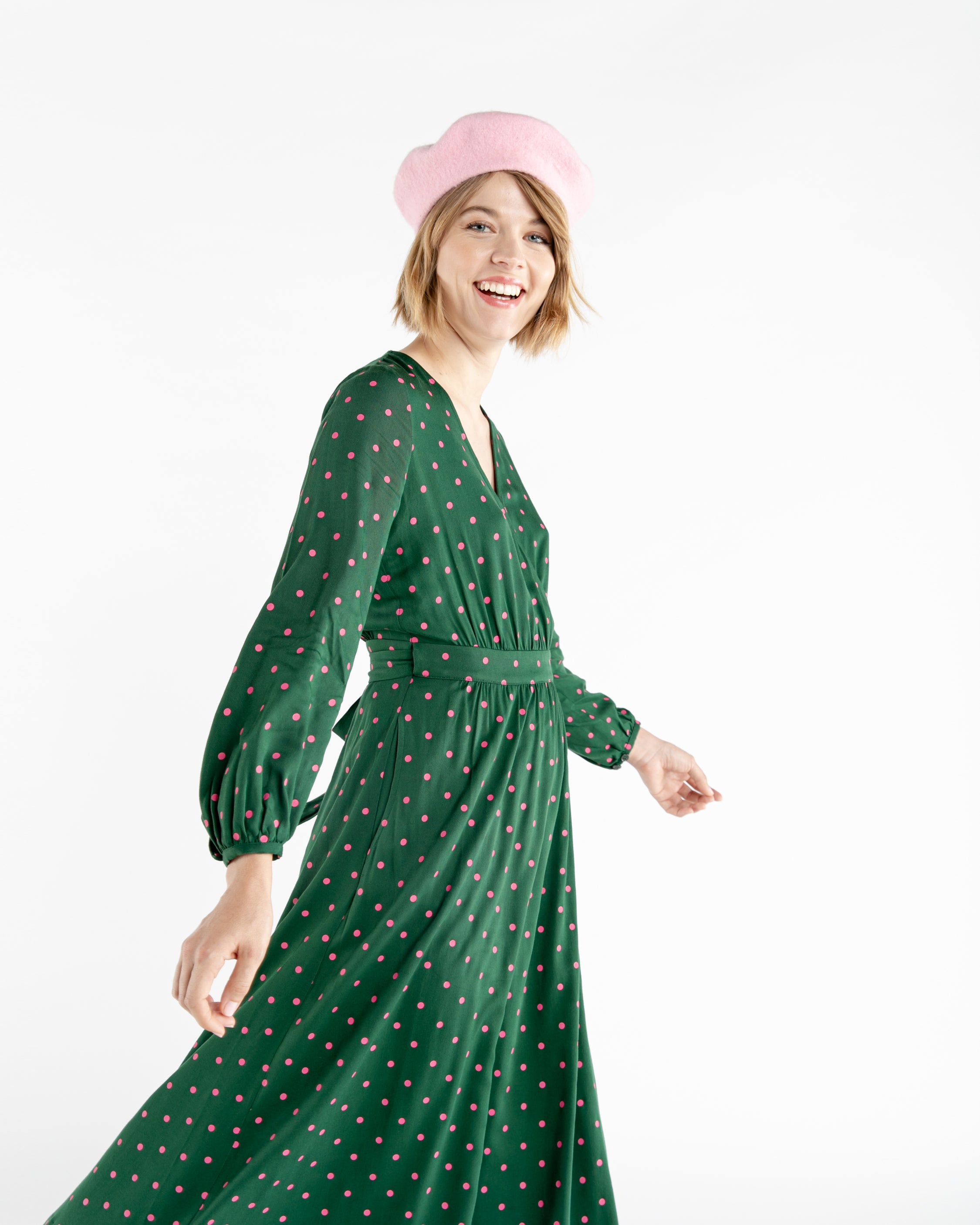Size adjustable green polka dot wrap dress with a long tie belt.