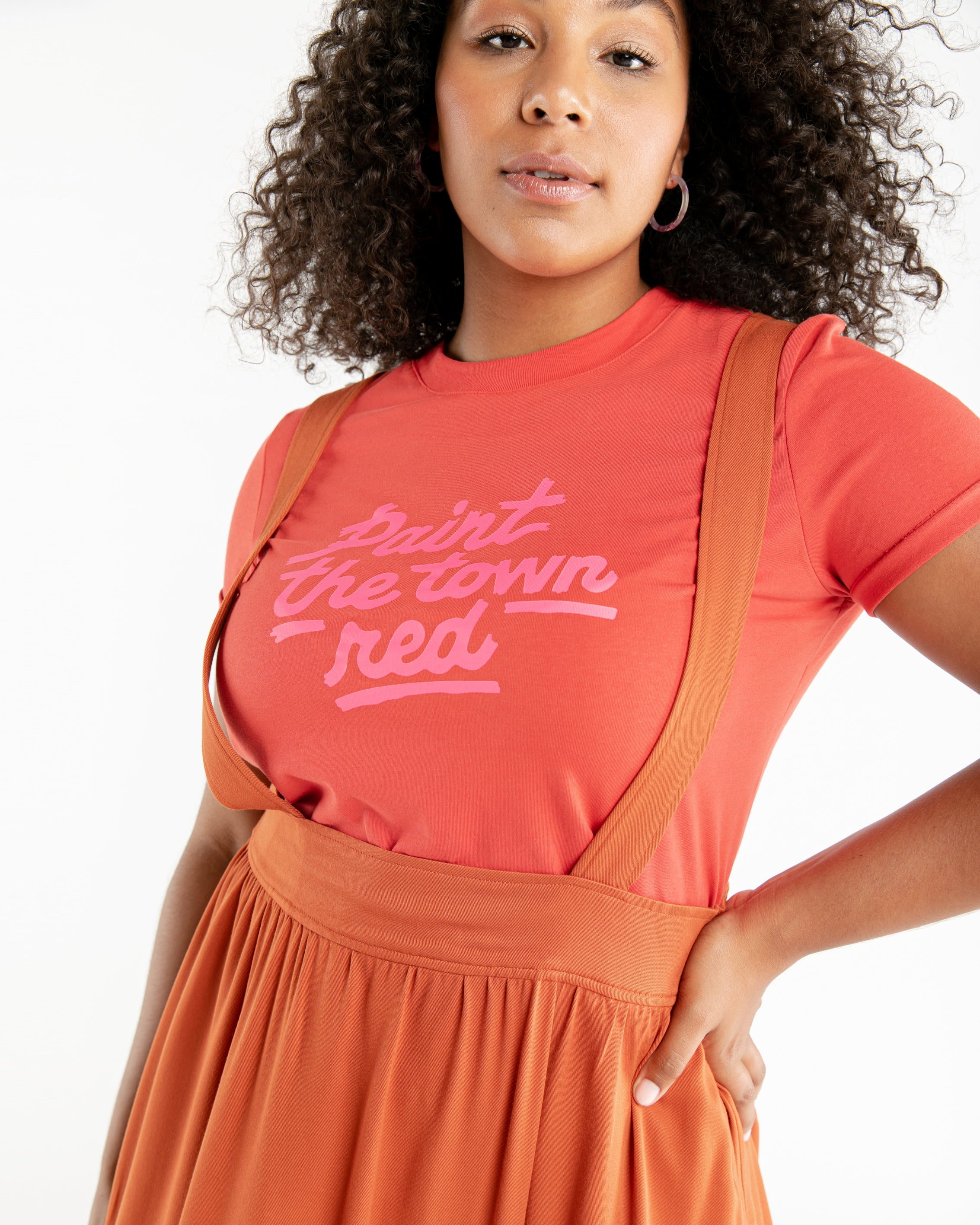 This tee comes in red, with 'Paint The Town Red' printed in pink on the front.