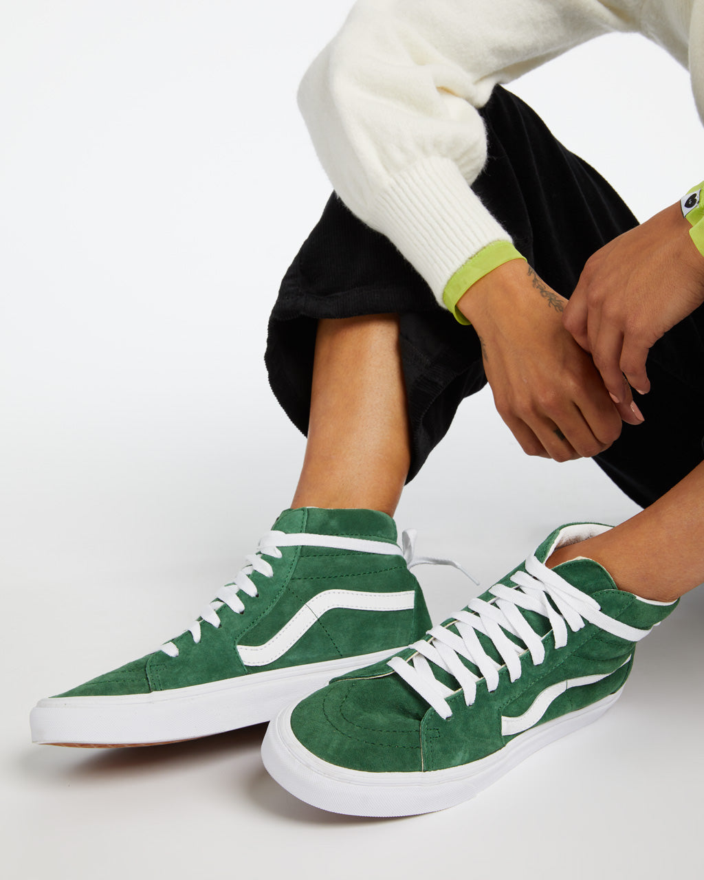 These Sk8-Hi shoes by Vans come in fairway green with white accents.