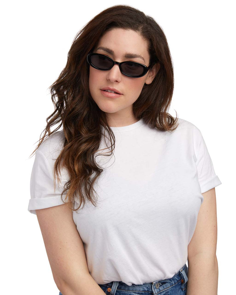woman wearing black oval sunglasses