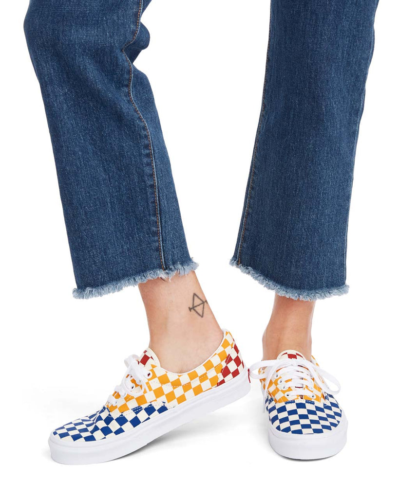 These Vans Era shoes come in a multi-colored checkerboard pattern.