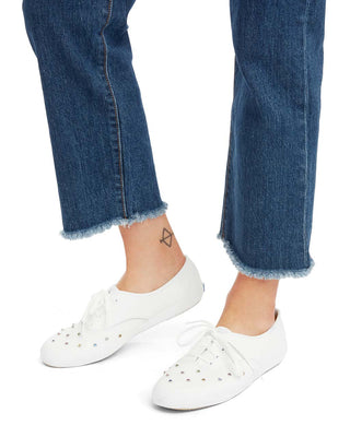 These Keds Champion Sneakers come in white, with rhinestone stud detail.