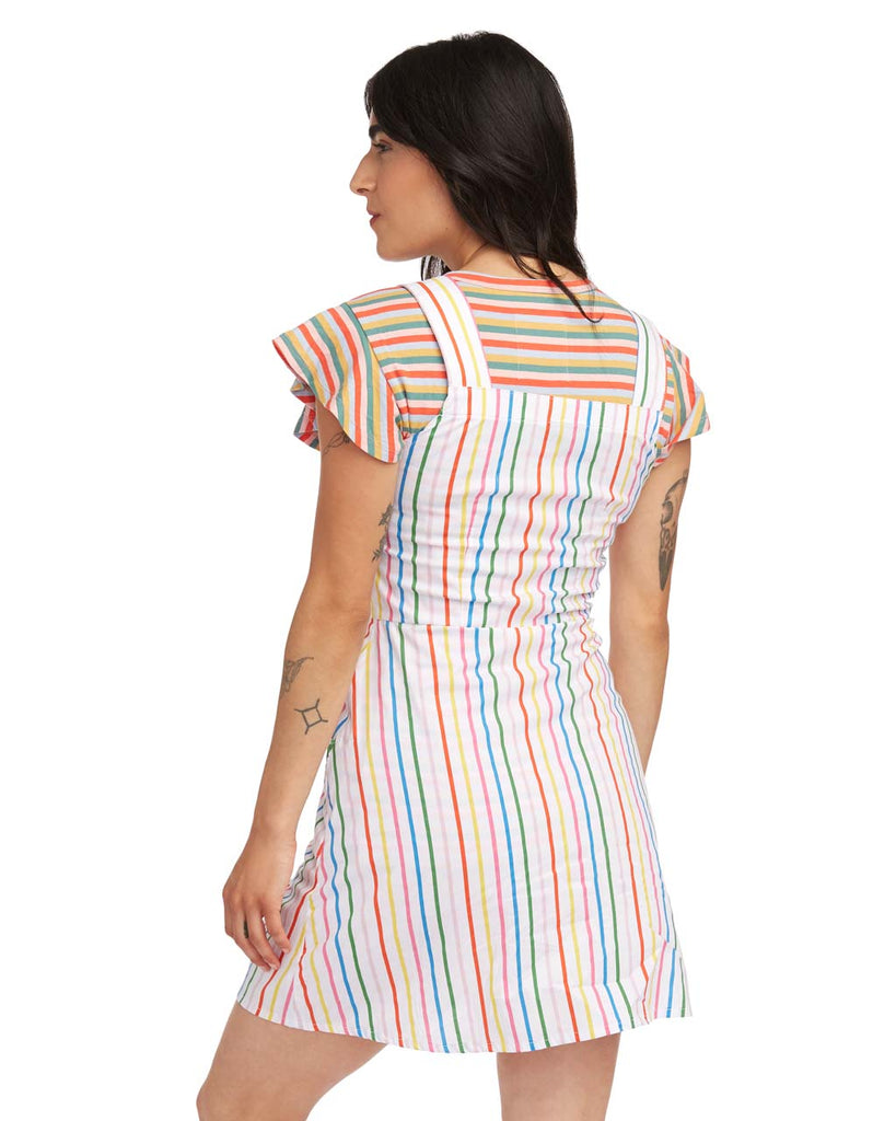 back view of woman wearing the rainbow stripe overall dress