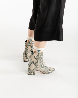 These boots from Dolve Vita come in a light snakeskin design.