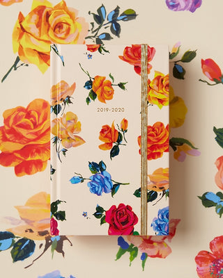 This Classic 17-Month Annual Planner comes with a cream and colorful floral matte-laminated hard cover, designed by Helen Dealtry.