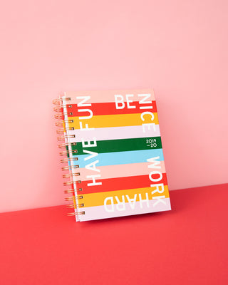 This Medium 17-Month Annual Planner comes in a matte-laminated, rainbow-striped hard cover.