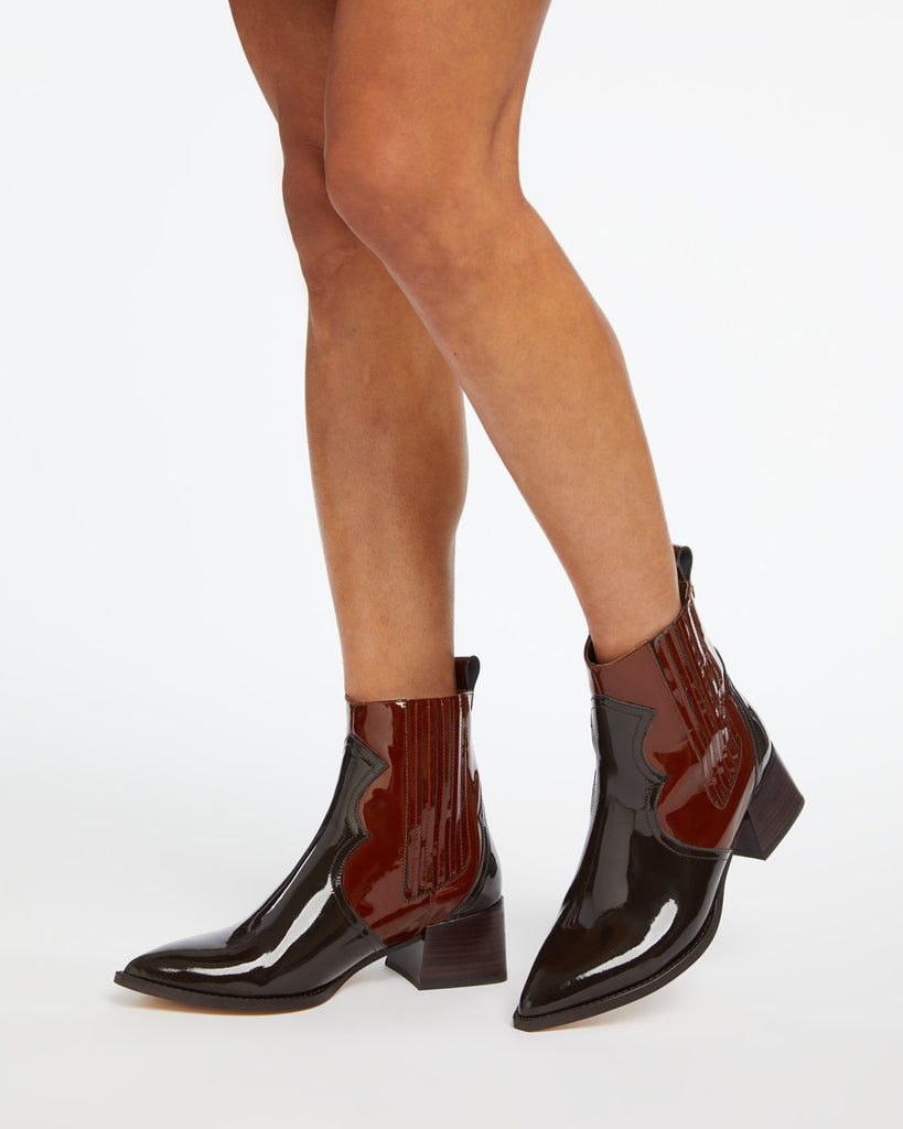 Two tone brown western inspired patent boots.