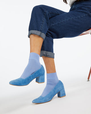 Blue corduroy heels with tonal blue ankle socks.