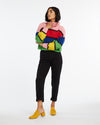 Multi-color striped turtleneck sweater.