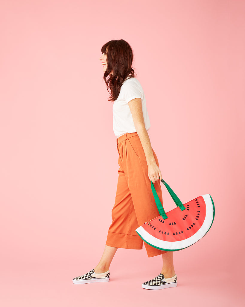 woman carrying a watermelon cooler bag