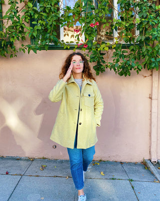 model shown wearing light green jacket