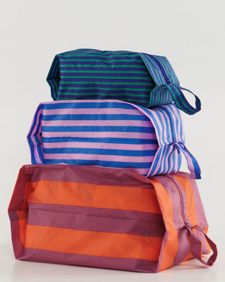 a stack of 3 zip pouches
