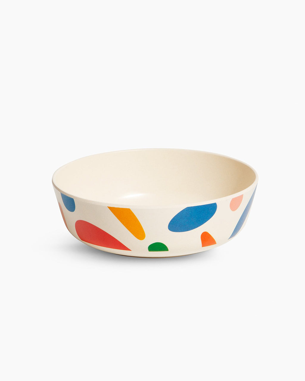 cream colored bowl with multi colored abstract blots