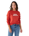 "Woman in a red long sleeve sweatshirt with a white ""Room Service"" graphic in the center."