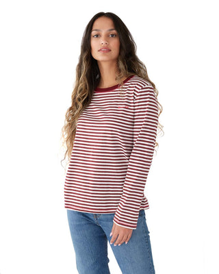 Woman in a long sleeve red and white striped t-shirt.