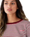 "Red and white striped tshirt with ""ban.do"" in hot pink embroidery in the corner"