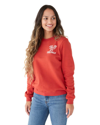 "Woman in a red long sleeve sweatshirt with a small white graphic in the right corner that reads ""Ask me about my feelings."""